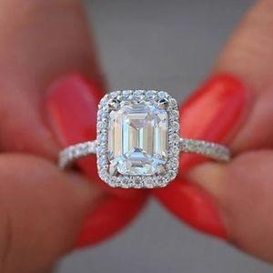 18k White Gold Emerald Cut Diamond Halo Ring